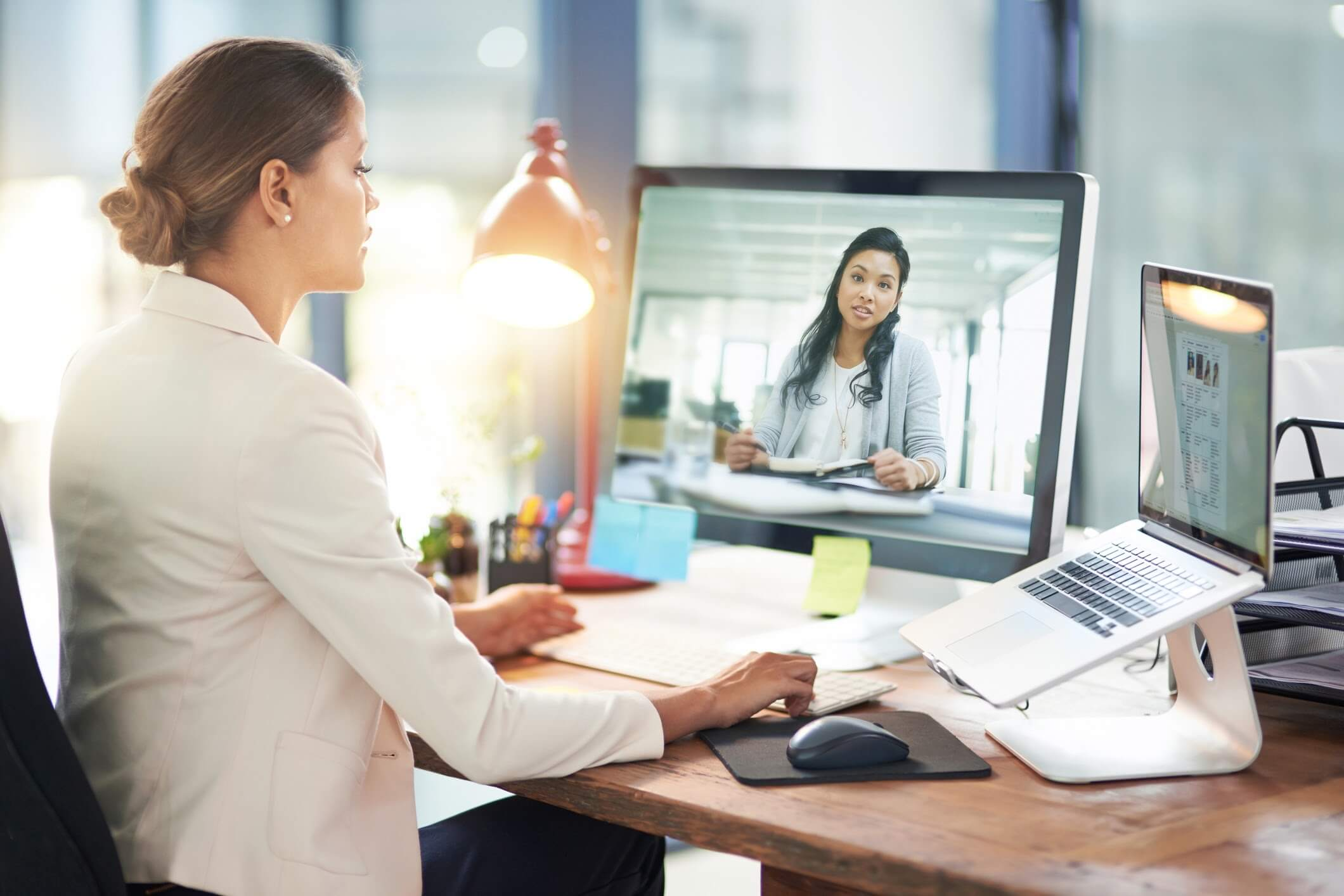 Business owner delegating tasks to a member of her virtual team on a video conference